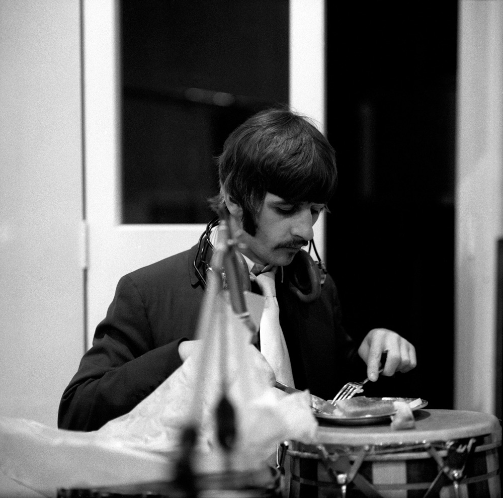 Ringo Starr eating in between a Sgt. Pepper recording session, 1967.