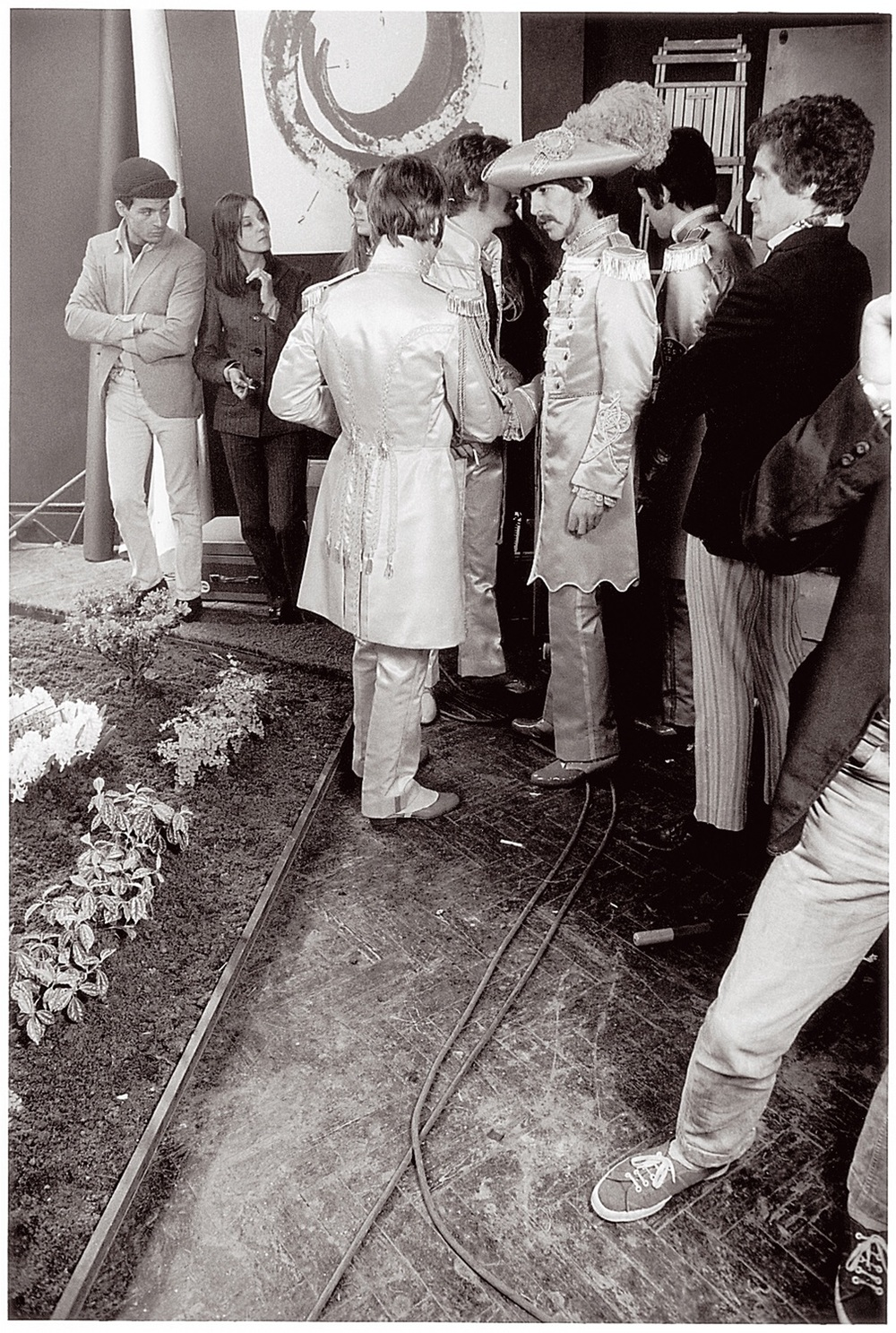Members of Sgt. Pepper's Lonely Hearts Club Band getting ready for their photo shoot, March 1967.
