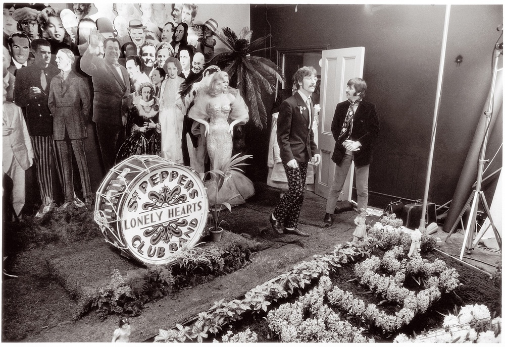 John Lennon and Ringo Starr standing beside a near-completed Sgt. Pepper's Lonely Hearts Club Band album cover, March 1967.