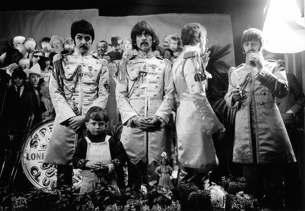 The Beatles with Adam Cooper, son of Michael Cooper; the Sgt. Pepper album photographer, March 1967.