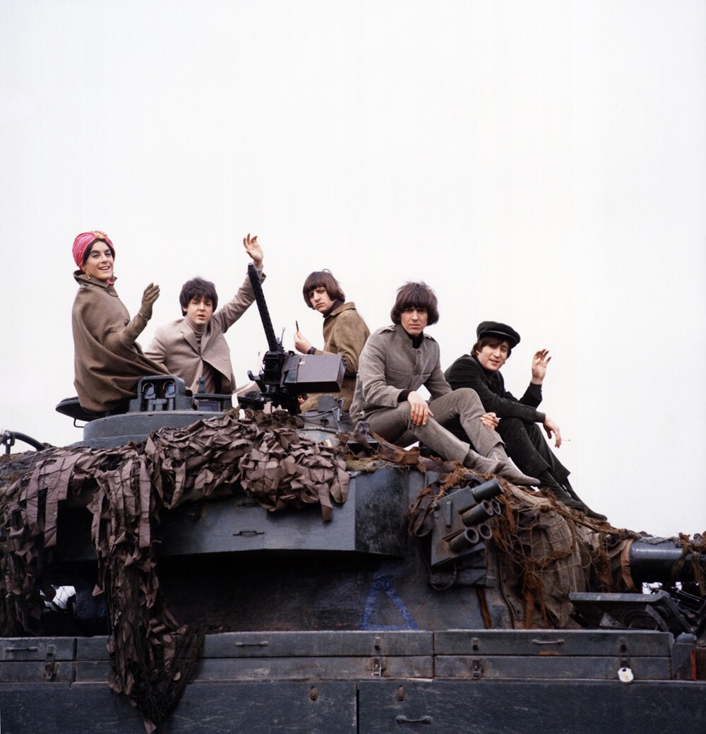 The Beatles on a tank with actress Eleanor Bron  on the Salisbury Plain, Wiltshire, May 1965.
