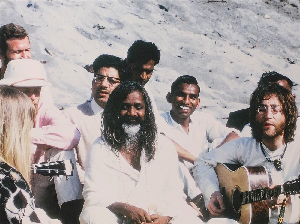 John Lennon playing his guitar for Maharishi Mahesh Yogi, India 1968.
