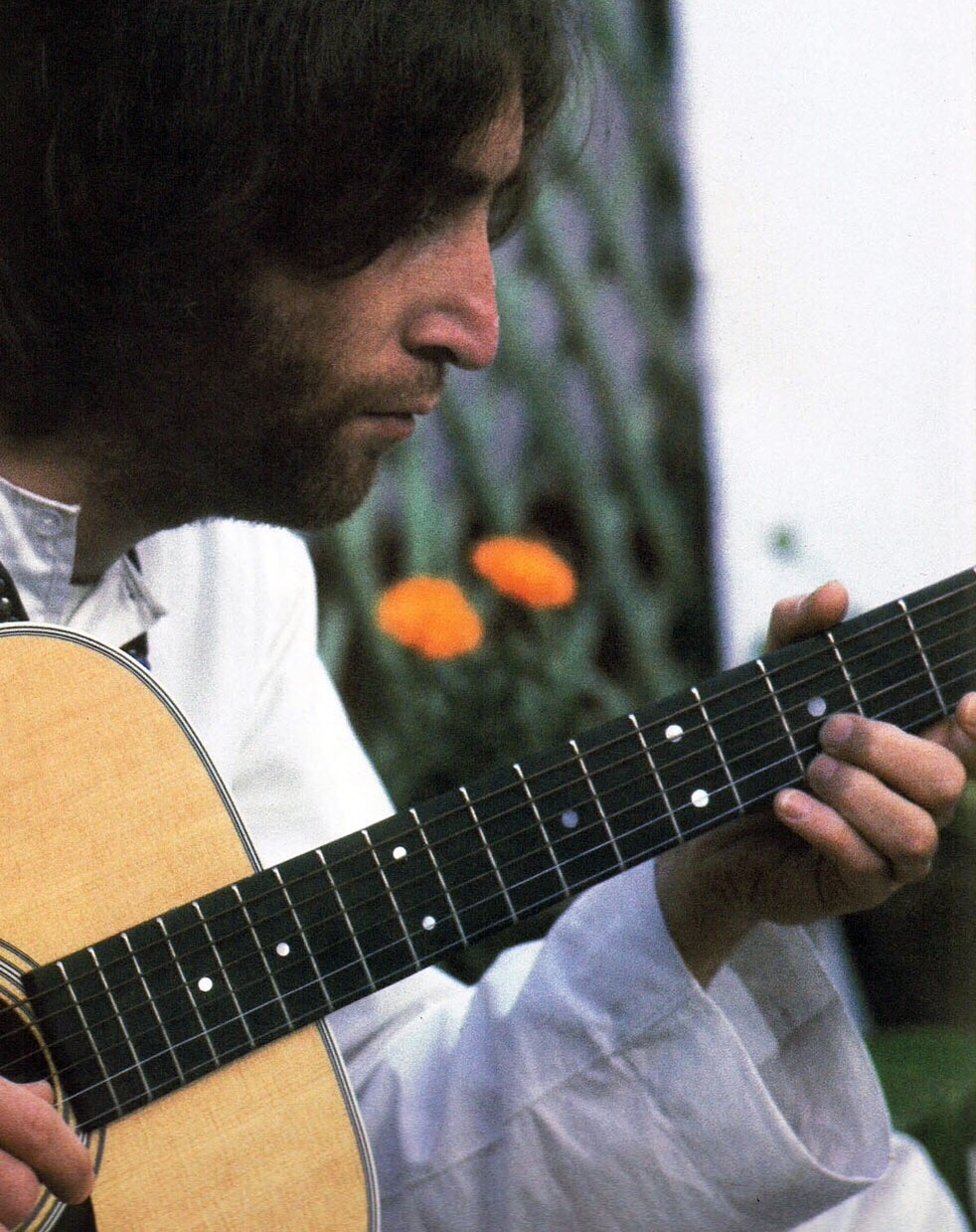 Dear Prudence. John Lennon playing his guitar in India, 1968.