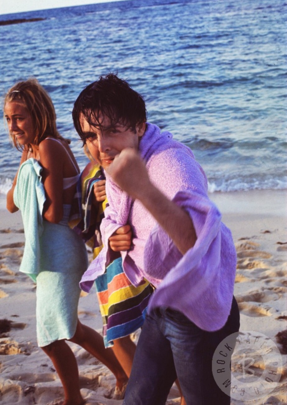 Paul McCartney with an unknown woman in the Bahamas, 1965.