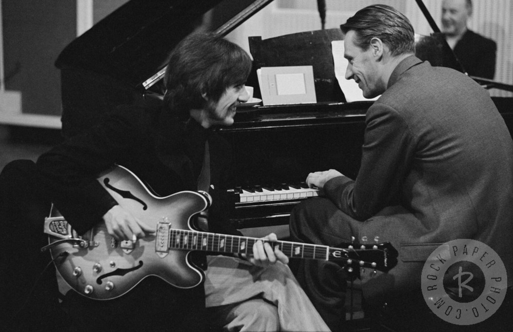 George Harrison and George Martin share a laugh during a Sgt. Pepper session, 1967.