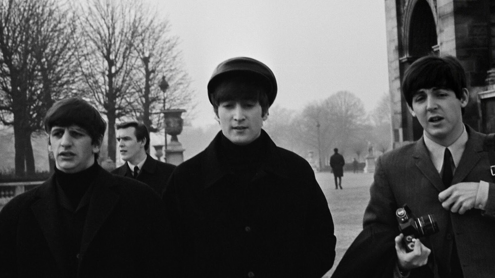 Ringo, John and Paul taking in Paris, January 1964.