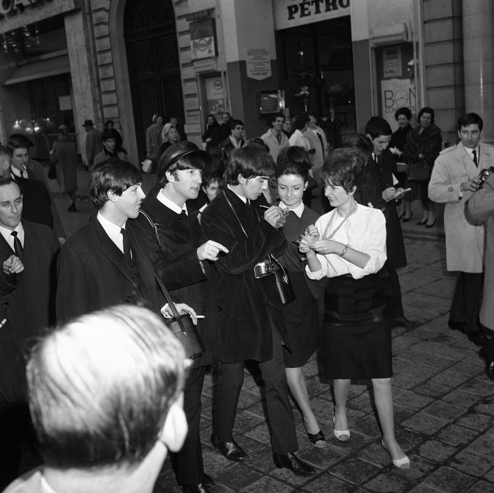 The Beatles signing autographs in Paris, January 1964.