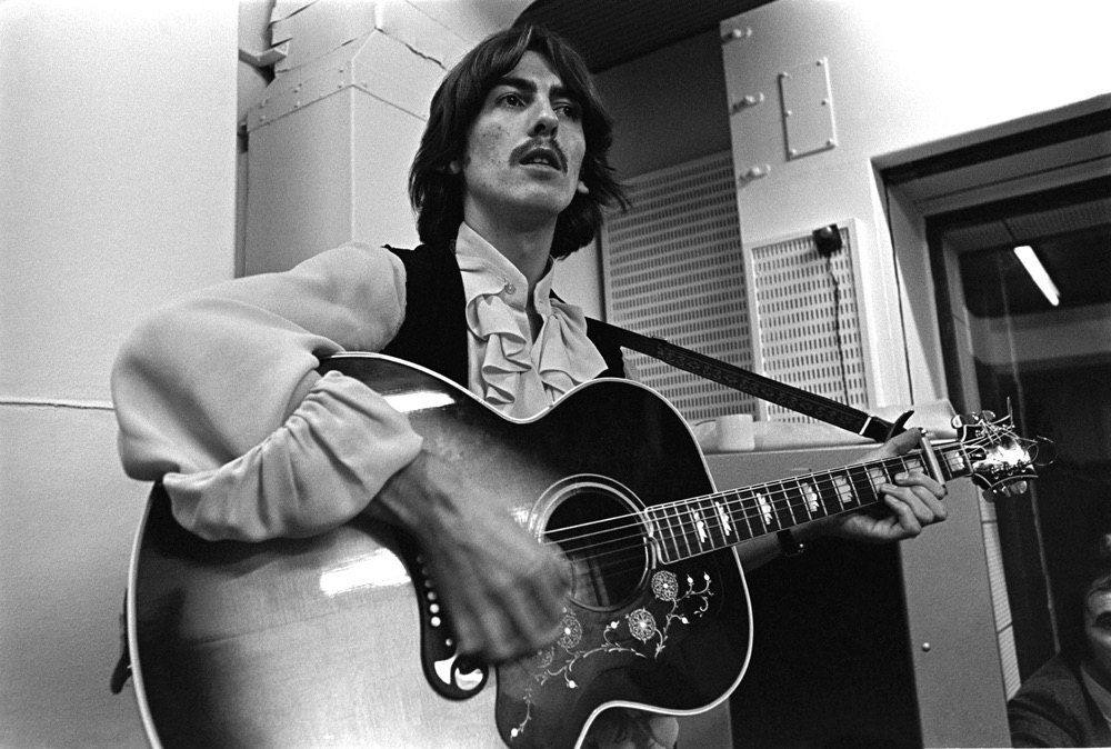 George Harrison playing acoustic guitar at a White Album session, 1968.