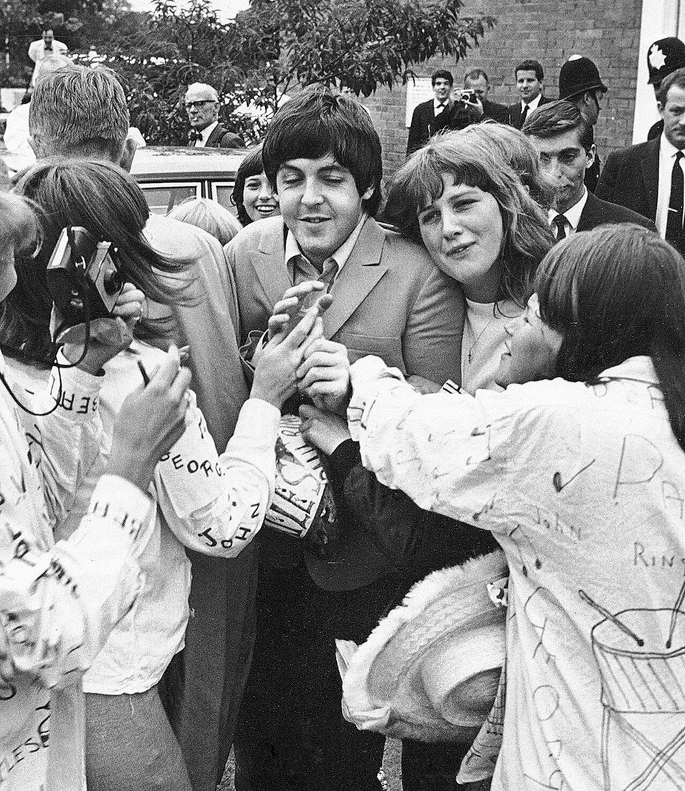 Paul McCartney getting mobbed by fans, 1965.