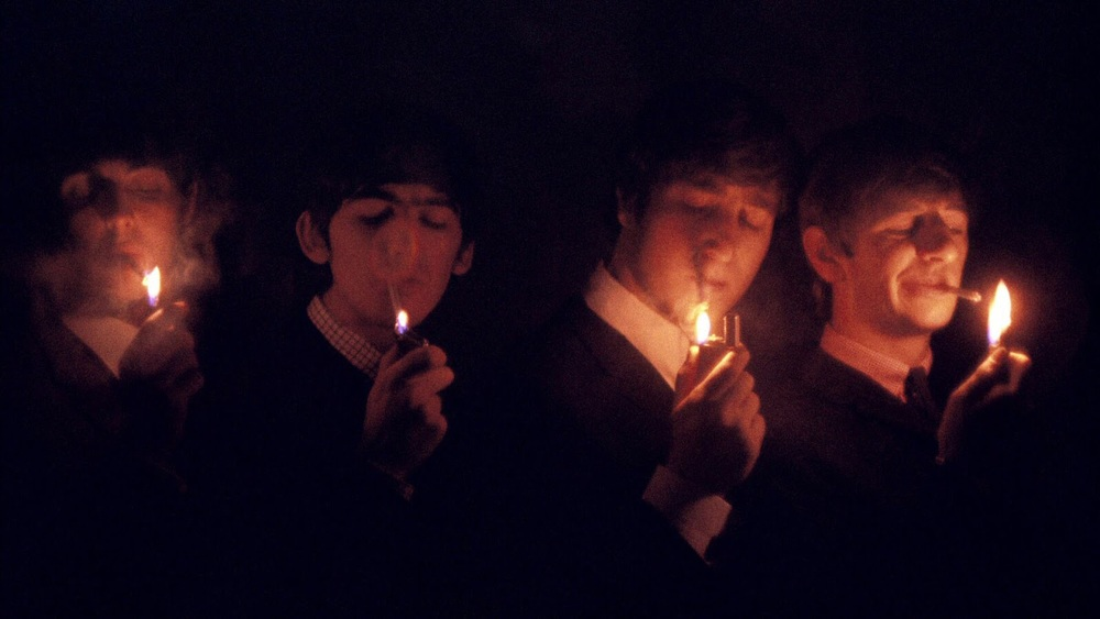 The Beatles all lighting a cigarette, 1964.