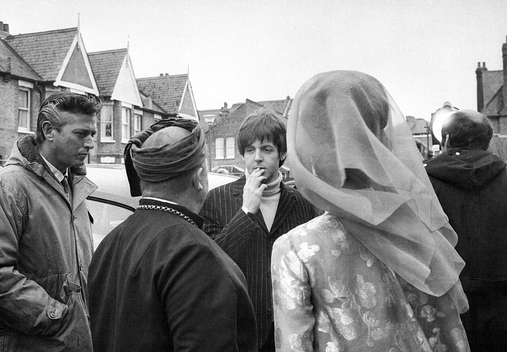 Paul McCartney with the cast of Help! 1965.