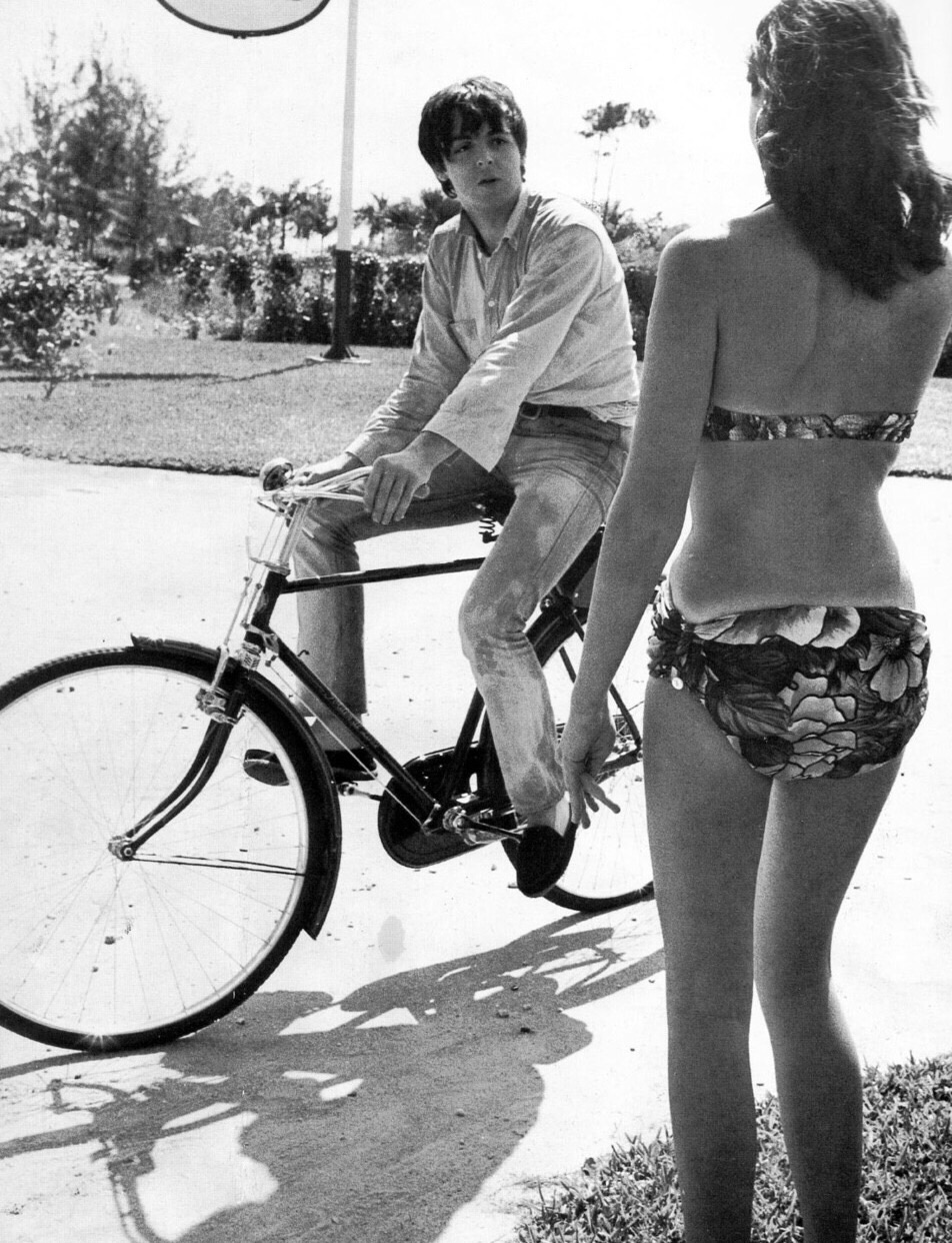 Paul McCartney chatting with an unknown woman in the Bahamas, 1965.