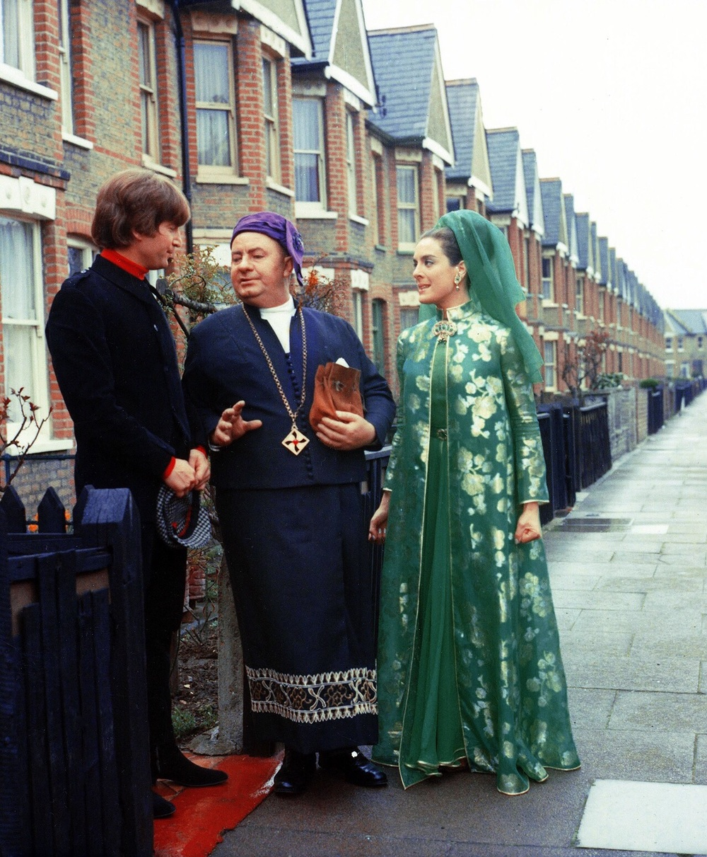 John Lennon with Eleanor Bron filming a scene for Help! 1965.