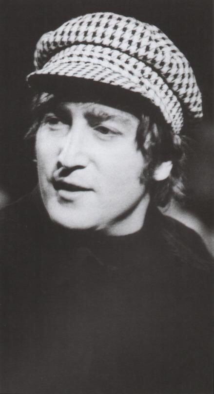 John Lennon with a cap, 1965.