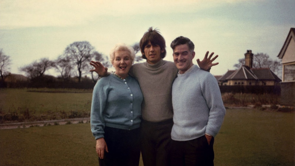 Rare photo of George Harrison with his parents, 1966.
