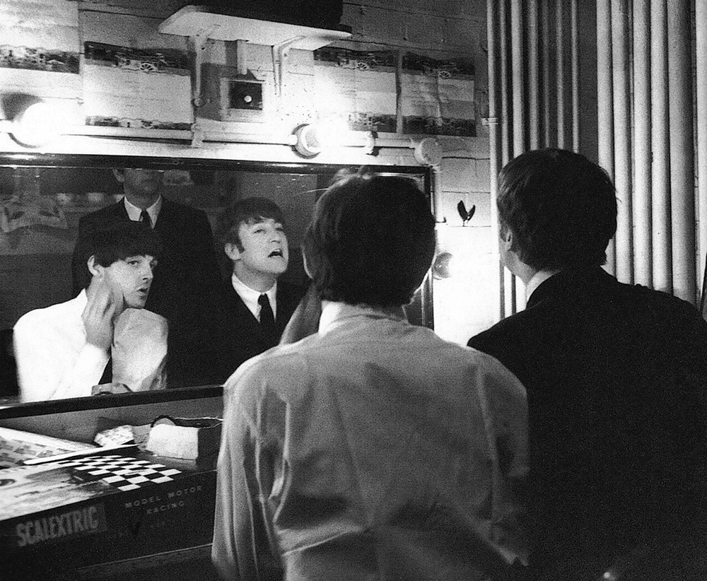 John Lennon and Paul McCartney in a dressing room, 1964.