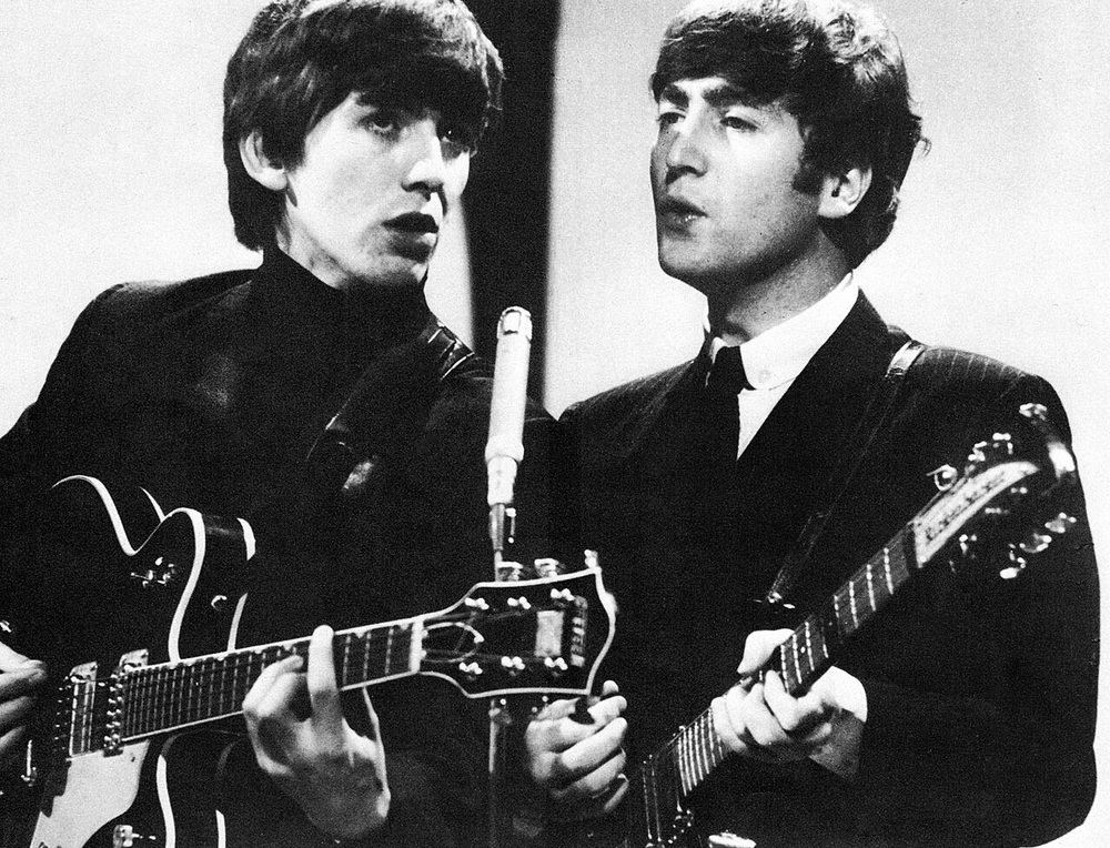 George Harrison and John Lennon 1964.