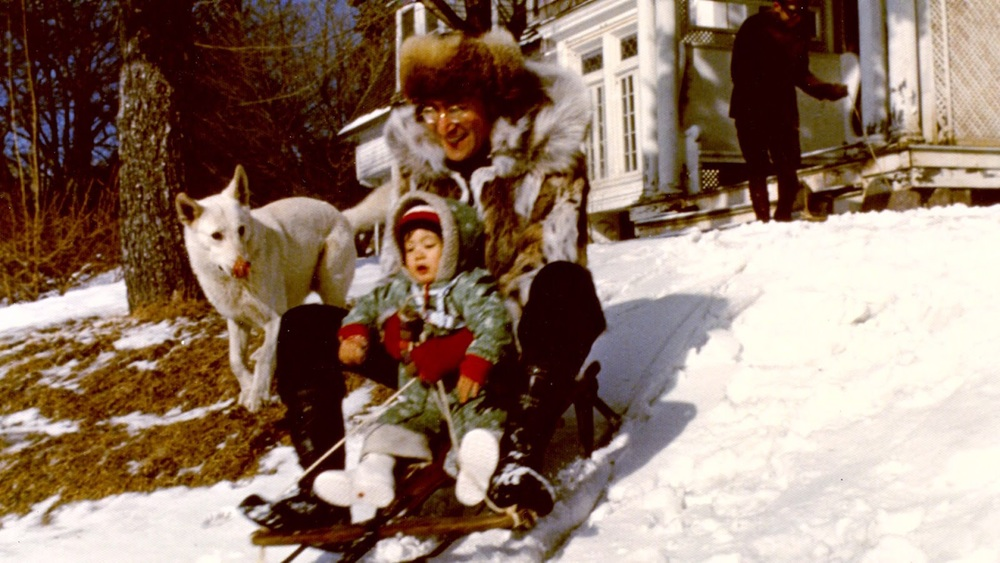 John Lennon riding a sleigh with Sean Lennon, 1977.