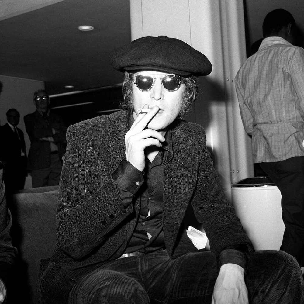 John Lennon at Heathrow Airport, 1971.