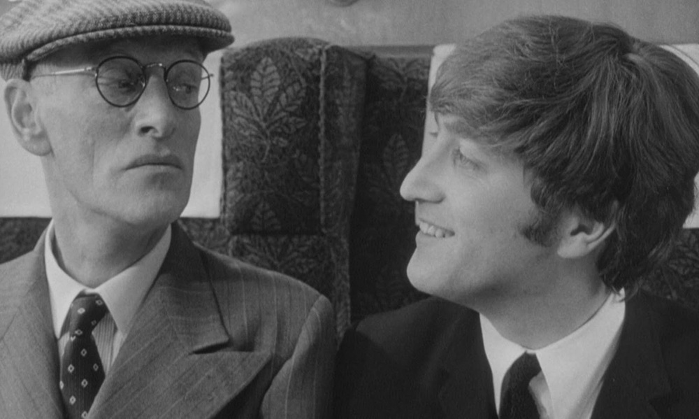 John Lennon and Wilfrid Brambell filming A Hard Day's Night, 1964.