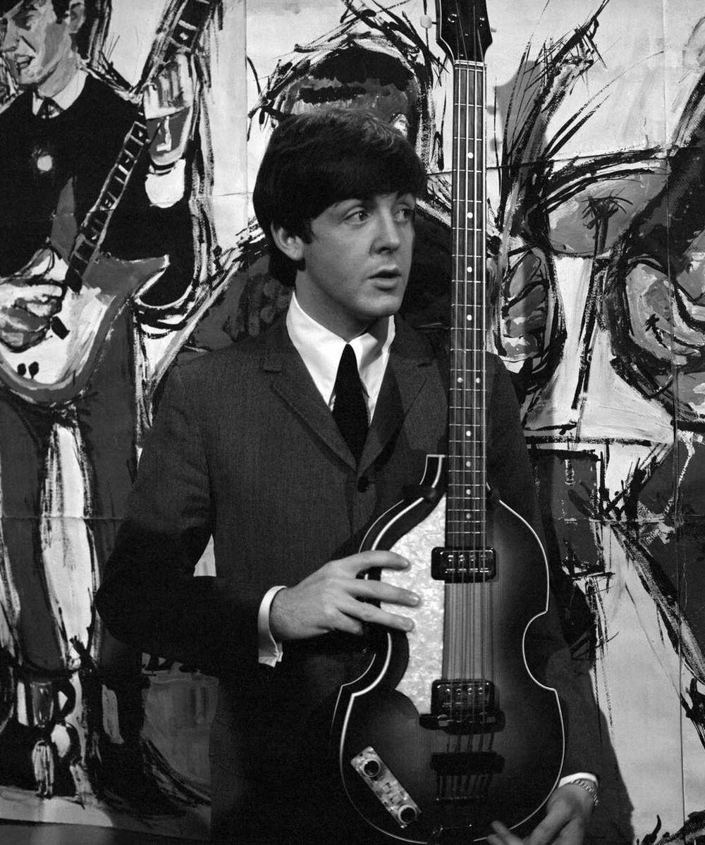 Paul McCartney sporting his Hofner bass on the set of Ready Steady Go!, 1964.
