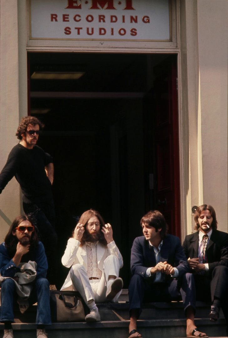 The Beatles sitting outside Abbey Road Studios, August 8th 1969.