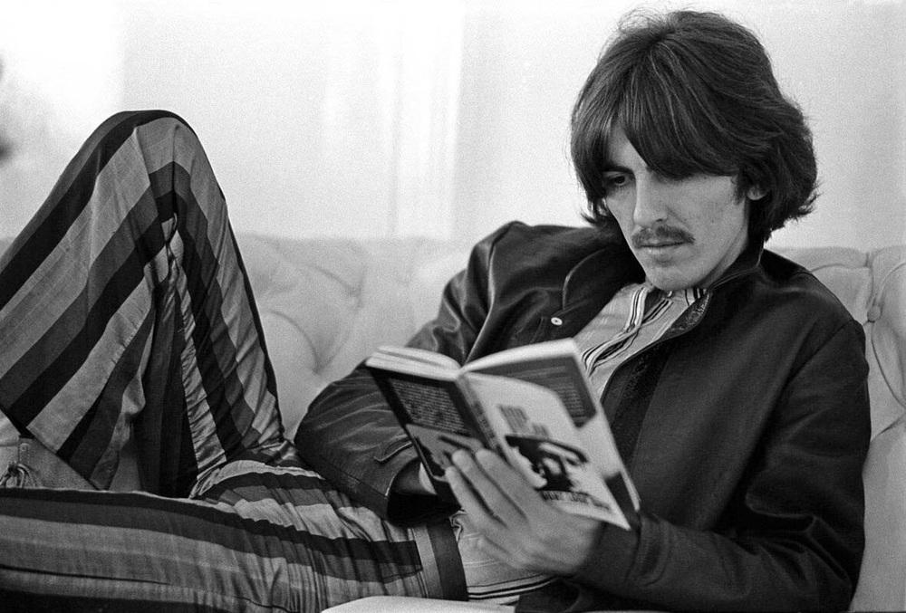 George Harrison reading a book on Bob Dylan, 1967.