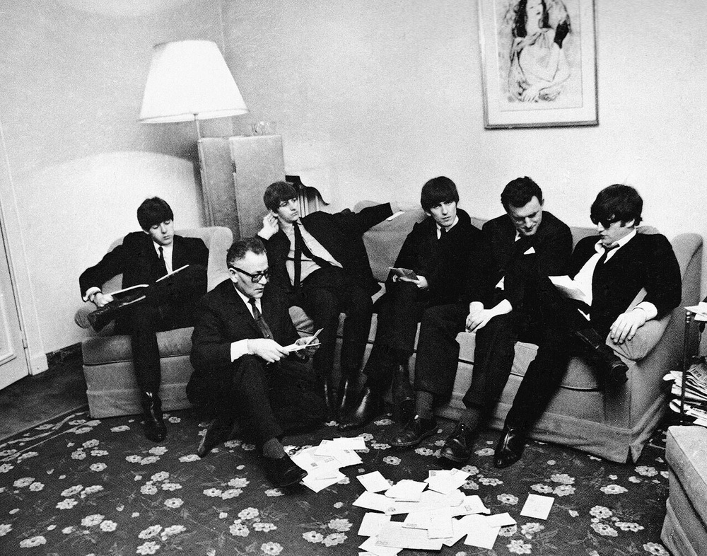 The Beatles looking through fan mail, 1964.