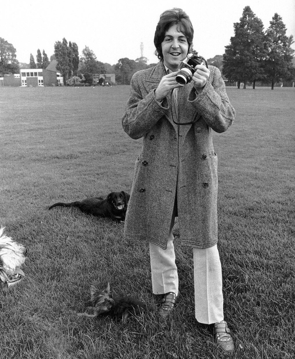 Paul McCartney out with his dogs and camera, 1968.