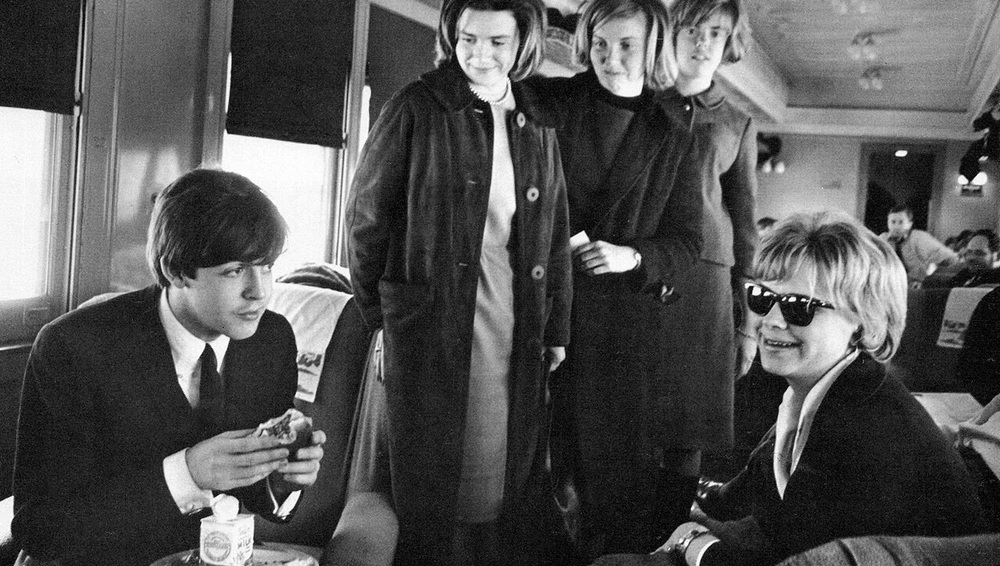 Paul McCartney on a train, 1964.