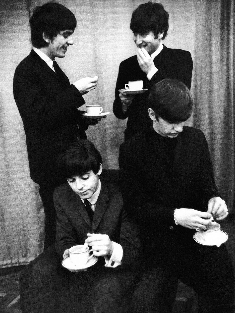 The Beatles drinking tea, 1964.