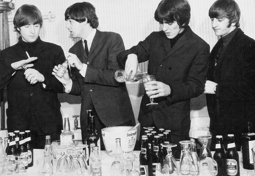 The Beatles enjoying a few drinks, 1964.