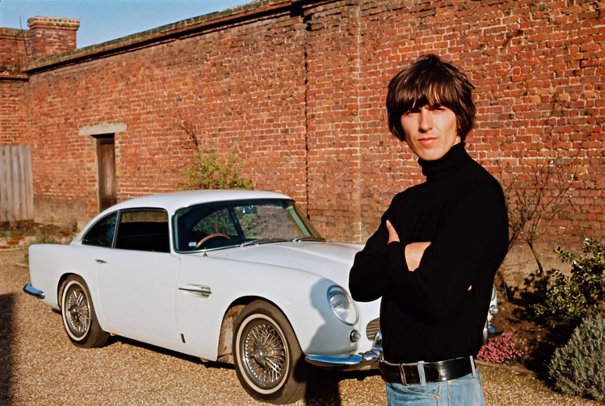 George Harrison with his Aston Martin, 1965.