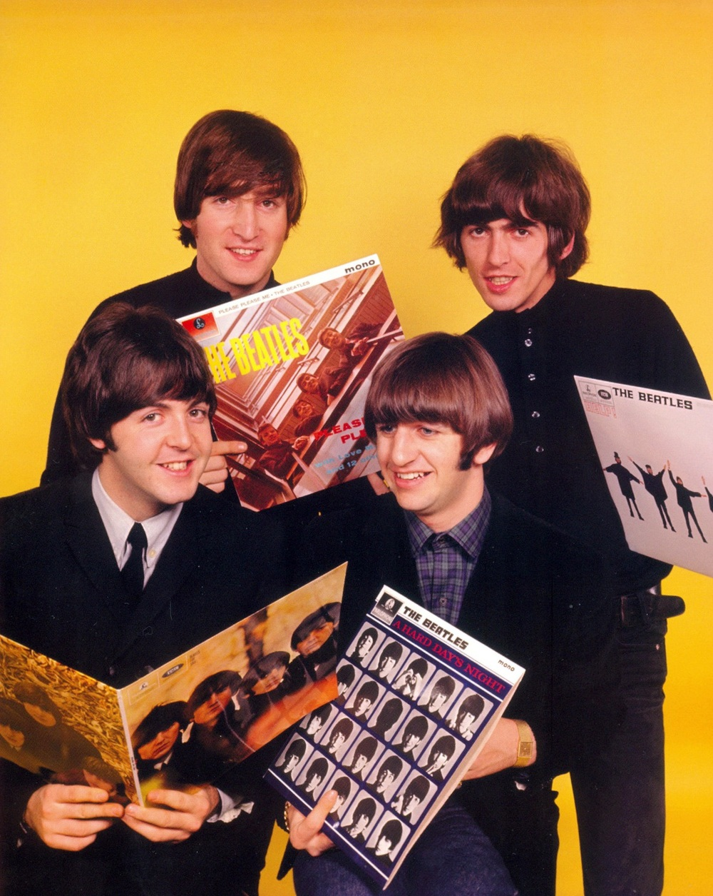 The Beatles holding some Beatles' LPs, 1964.