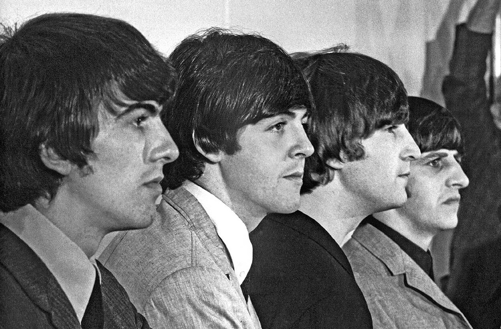 The Beatles at a press conference, circa 1965.