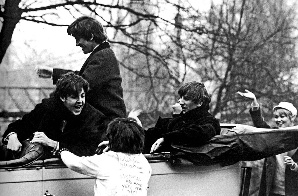 The Beatles in a horse and cart, 1964.