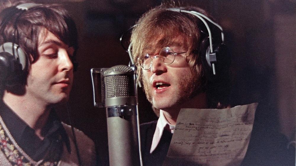 Paul McCartney and John Lennon recording vocals, 1968.