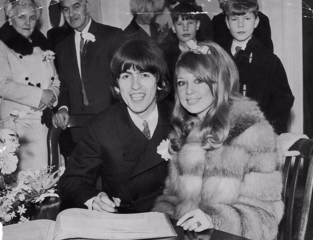 George Harrison and Pattie Boyd signing the marriage register, January 21st 1966.