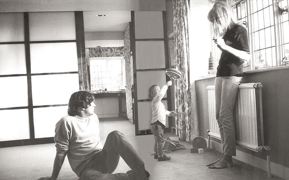 John and Cynthia Lennon with Julian at their home in Weybridge, 1965.