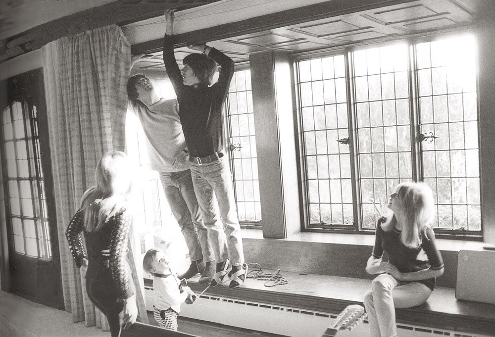 John, Cynthia and Julian Lennon with George Harrison and Pattie Boyd at the Lennon's home in Weybridge, 1965.
