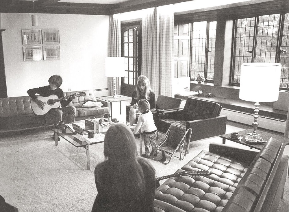 Cynthia and Julian Lennon with George Harrison and Pattie Boyd at the Lennon's home in Weybridge, 1965.