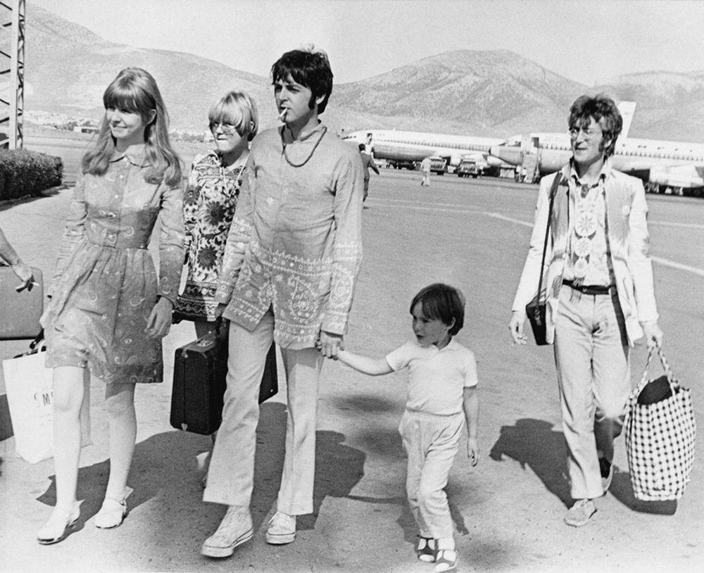 """Julian Lennon with """"uncle"""" Paul on the way to Greece, 1967."""