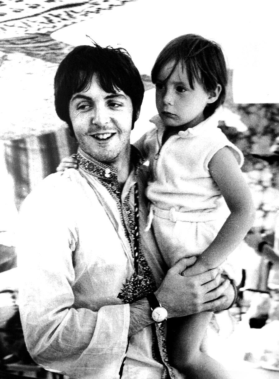 "Julian Lennon with ""uncle"" Paul on the way to Greece, 1967."
