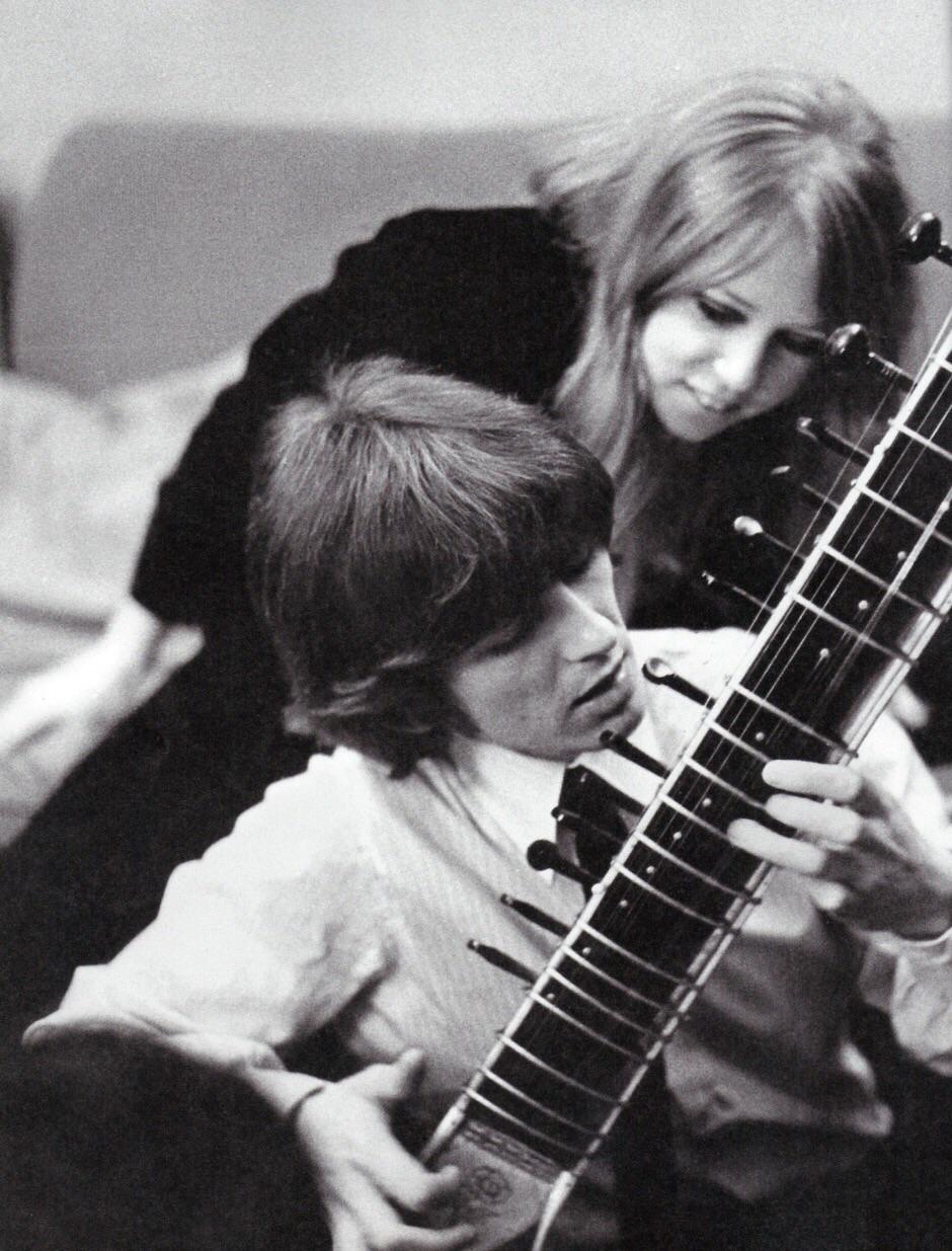 George Harrison practising sitar with Pattie Boyd, 1966.