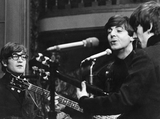 John Lennon, Paul McCartney and George Harrison recording at the BBC, 1963.