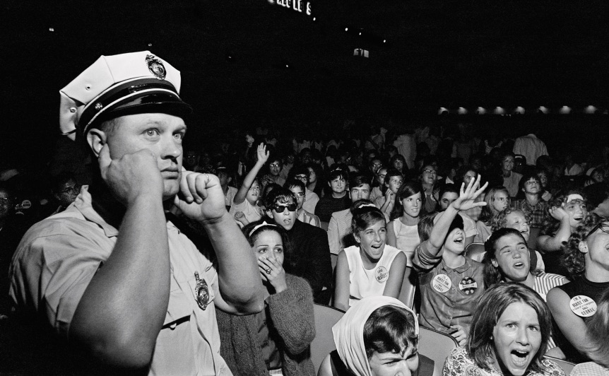 Policeman plugs his ears at the Beatles' concert at Atlantic City, New Jersey, August 30th 1964.