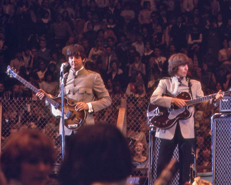 Paul McCartney and George Harrison at the Cow Palace, San Francisco, August 31st, 1965.
