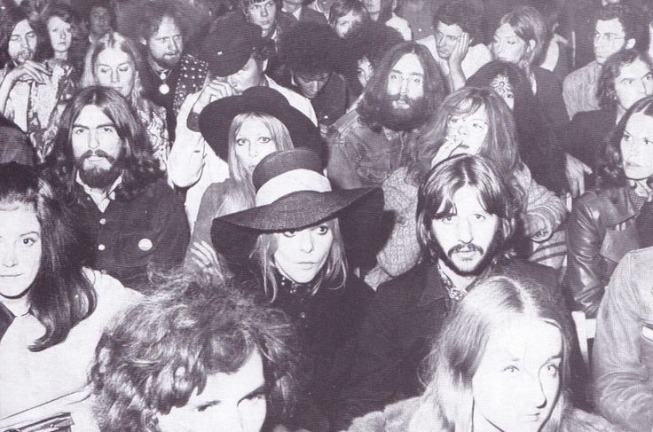George and Pattie Harrison, Ringo and Maureen Starkey and John and Yoko Lennon watch Bob Dylan perform at the Isle of Wight festival, August 31st, 1969.