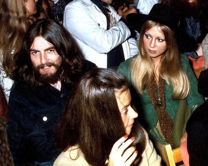 George and Pattie Harrison watch Bob Dylan perform at the Isle of Wight festival, August 31st, 1969.