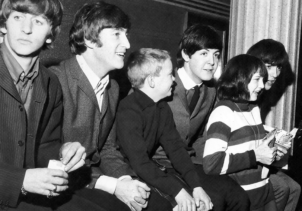 The Beatles with some young fans, 1964.